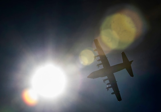 A C-130 Hercules makes a pass before taking part in a static-line jump, Feb. 19, 2015, near Tifton, Ga. Members from the 820th Base Defense Group can be tasked at a moments notice to support operations around the world, and have remain qualified on all aspects of their job, including static-line jumps. The C-130 is from Moody Air Force Base, Ga. (U.S. Air Force photo/Staff Sgt. David Salanitri)