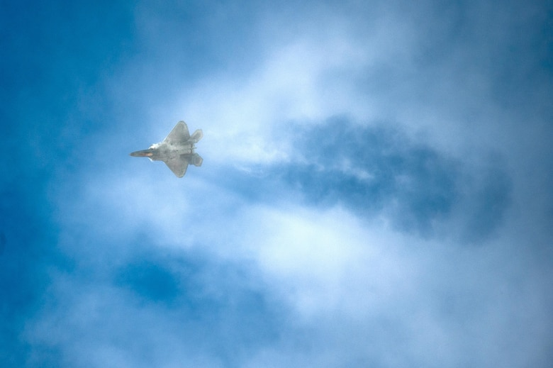 An F-22 Raptor cuts through the clouds during the 2015 Heritage Flight Training and Certification Course March 1, 2015, at Davis-Monthan Air Force Base, Ariz. The annual aerial demonstration training event has been held at Davis-Monthan AFB since 2001, providing civilian and military pilots the opportunity to practice flying in formation for the upcoming air show season. (U.S. Air Force photo/Airman 1st Class Chris Massey)