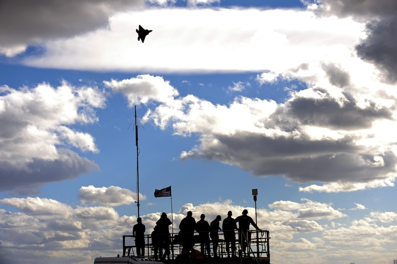 An F-22 Raptor flies above spectators during the 2015 Heritage Flight Training and Certification Course Feb. 28, 2015, at Davis-Monthan Air Force Base, Ariz. The annual aerial demonstration training event has been held at Davis-Monthan AFB since 2001, providing civilian and military pilots the opportunity to practice flying in formation together for the upcoming air show season. (U.S. Air Force photo/Airman 1st Class Chris Drzazgowski)