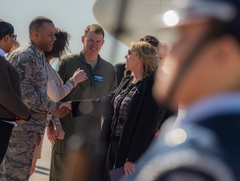 Secretary of the Air Force Deborah Lee James shakes hands with Chief Master Sgt. David Brown Feb. 18, 2015, upon her arrival at Mountain Home Air Force Base, Idaho. During her visit James was the guest speaker at the base's annual awards ceremony and spent time meeting with the Airmen who accomplish the mission every day. Brown is the 366th Fighter Wing command chief. (U.S. Air Force photo/Airman 1st Class Jessica H. Smith)