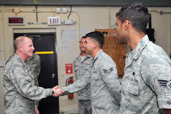 Lt. Gen. Stephen Wilson, commander of Air Force Global Strike Command, recognizes 36th Expeditionary Aircraft Maintenance Squadron Continuous Bomber Presence consolidated tool kit Airmen for their problem-solving initiatives March 3, 2015, at Andersen Air Force Base, Guam. Wilson met one-on-one with Airmen supporting the CBP mission in the Asia-Pacific region as well as recognized a handful of them who came up with problem-solving initiatives during their deployment here. (U.S. Air Force photo by Staff Sgt. Melissa B. White/Released)
