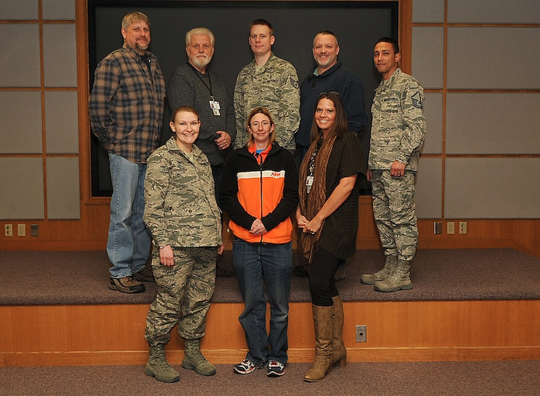 1st Lt. Jessica Swaim (far left, front row), 319th Medical Support Squadron resource management office and systems flight commander, poses with her flight for a group photo March 5, 2015, on Grand Forks Air Force Base, N.D. Swain was chosen as Warrior of the Week for the first week in March. (U.S. Air Force photo/Airman 1st Class Bonnie Grantham)