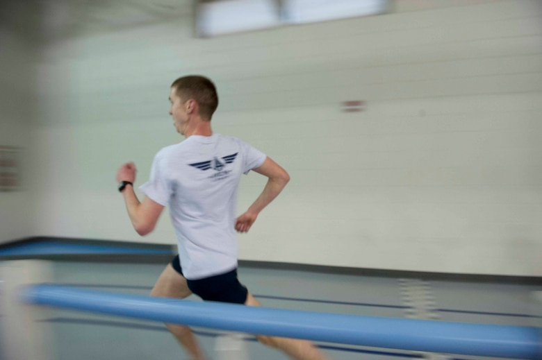 Airman 1st Class Augustin Sloan, personnelist from the 5th Force Support Squadron, sprints his last lap at the McAdoo Fitness Center on Minot Air Force Base, N.D. Feb. 11, 2015. Sloan makes time to run every day. (U.S. Air Force photo/Airman 1st Class Sahara L. Fales)