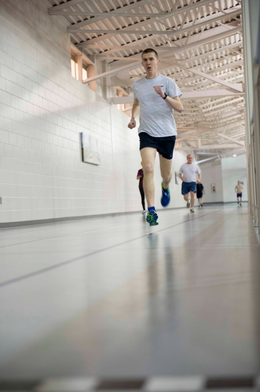 Airman 1st Class Augustin Sloan, personnelist from the 5th Force Support Squadron, runs at the McAdoo Fitness Center on Minot Air Force Base, N.D. Feb. 11, 2015. Sloan stays prepared for the Air Force Cross Country team by running long distance indoors during the winter and doing variations of sprinting exercises outdoors during the summer. (U.S. Air Force photo/Airman 1st Class Sahara L. Fales)