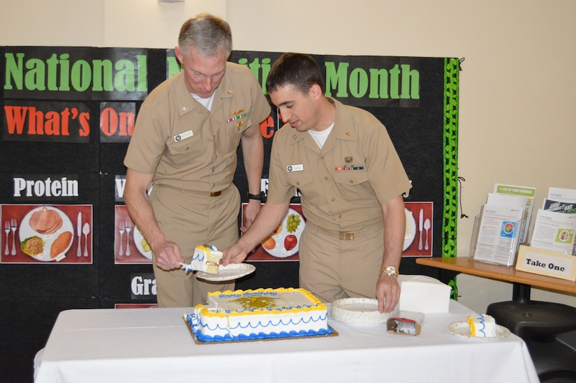 Captain Edward Butler, left, dermatologist for Naval Health Clinic Charleston, and Lt. Joseph Siegel, an NHCC physician, cut the cake during a celebration in honor of the 144th birthday of the ‪Navy Medical Corps‬ March 3, 2015 in the NHCC atrium at Joint Base Charleston, S.C. The Navy Medical Corps was March 3, 1871. (U.S. Navy / Kris Patterson)