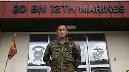 Japanese Ground Self-Defense Force 1st Lt. Ryota Hasebe attached to 3rd Battalion 12th Marines, 3rd Marine Division, III Marine Expeditionary Force for two months starting Jan. 11 and ending March 13 poses for a photo at Camp Hansen, Okinawa. During those two months Hasebe learned about U.S. Marine Corps artillery and went to Marine Air Ground Combat Center Twentynine Palms, California for Integrated Training Exercise 2-15. Hasebe, 28, studied Chinese Literature and graduated from Kokugakuin University in Tokyo before joining the JGSDF in 2011. Hasebe is now the battalion fire direction control officer for 1st Battalion, 4th Field Artillery Regiment in Fukuoka Japan.