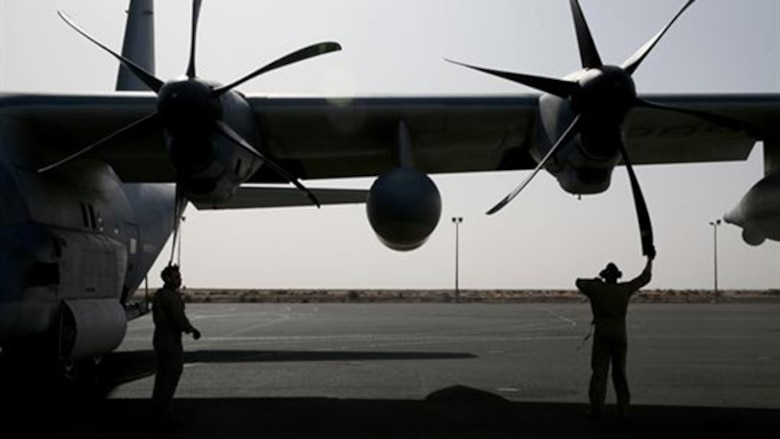U.S. Marine aircraft crewmen with Marine Aerial Refueler Transport Squadron 352, Special Purpose Marine Air Ground Task Force – Crisis Response – Central Command, perform pre-flight checks on a KC-130J Hercules aircraft before takeoff in the Central Command area of operations, Feb. 23, 2015. The Marines, sailors and aircraft with VMGR 352 support SPMAGTF – CR – CC by transporting supplies, equipment, and personnel to various locations in the region.
