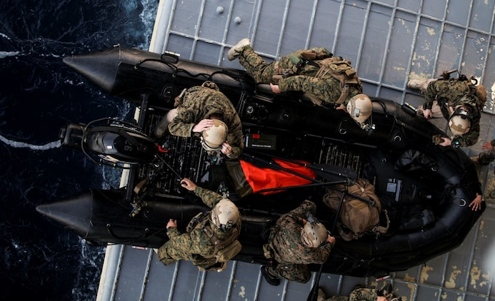 U.S. Marines with the 15th Marine Expeditionary Unit's Maritime Raid Force prepare to depart USS Essex (LHD 2) on a combat rubber raiding craft during Amphibious Squadron Three/Marine Expeditionary Unit Integration Training (PMINT) off the coast of San Diego March 4, 2015. The MRF used CRRCs during a precision raid exercise in preparation for their deployment later this spring. (U.S. Marine Corps photo by Cpl. Elize McKelvey/Released)