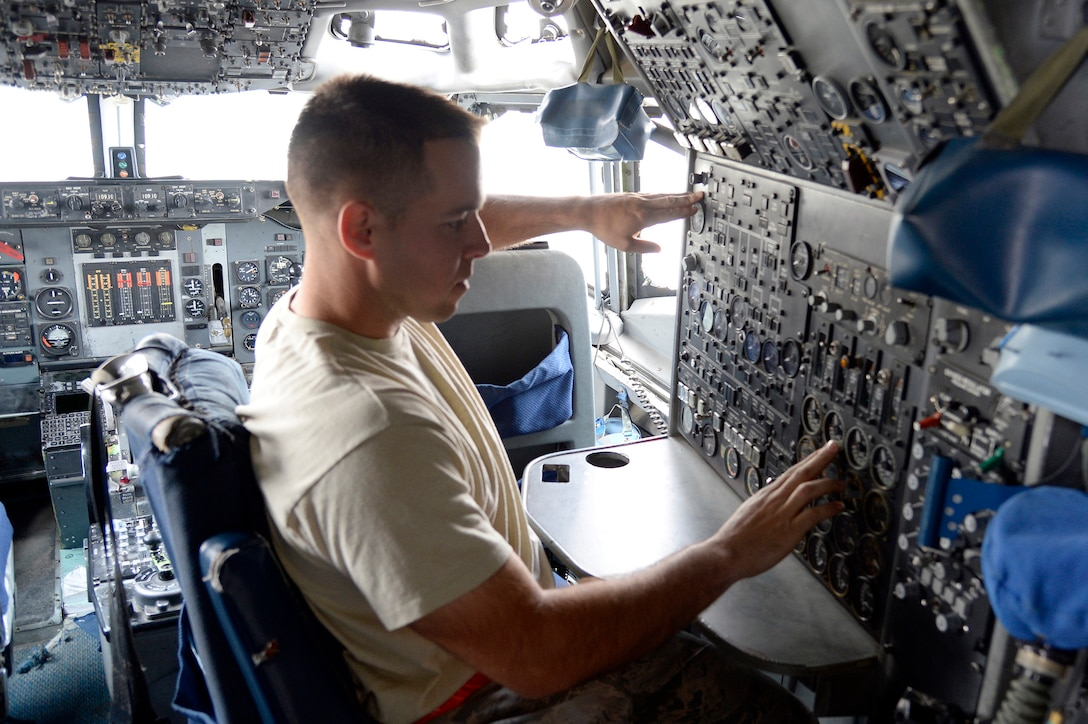 Staff Sgt. Derek, aerospace propulsion craftsman, verifies the fuel flow from an E-3 Sentry airborne warning and control system aircraft's auxiliary power unit at an undisclosed location in Southwest Asia Feb. 24, 2015. The Sentry Aircraft Maintenance Unit is a group of guardians who blend several special powers, ranging from radar to hydraulics, and band together to ensure the E-3 Sentry AWACS maintains its operational capability. Derek is currently deployed from Tinker Air Force Base, Okla., and is a native of Waterboro, Maine. (U.S. Air Force photo/Tech. Sgt. Marie Brown)