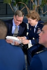 Intel Corporation's principal strategist Keith Uebele and Academy Superintendent Lt. Gen. Michelle D. Johnson chat about the inscribed piece of the terrazzo Uebele received from the Cadet Wing  during the 19th-annual Research Awards Ceremony here March 3, 2015.  Uebele was the event's keynote speaker and spoke to cadets about the value of research innovation.  Uebele is a liaison connecting Intel Corp with the Homeland Security Department's Center of Innovation here. (U.S. Air Force photo/Jason Gutierrez)
