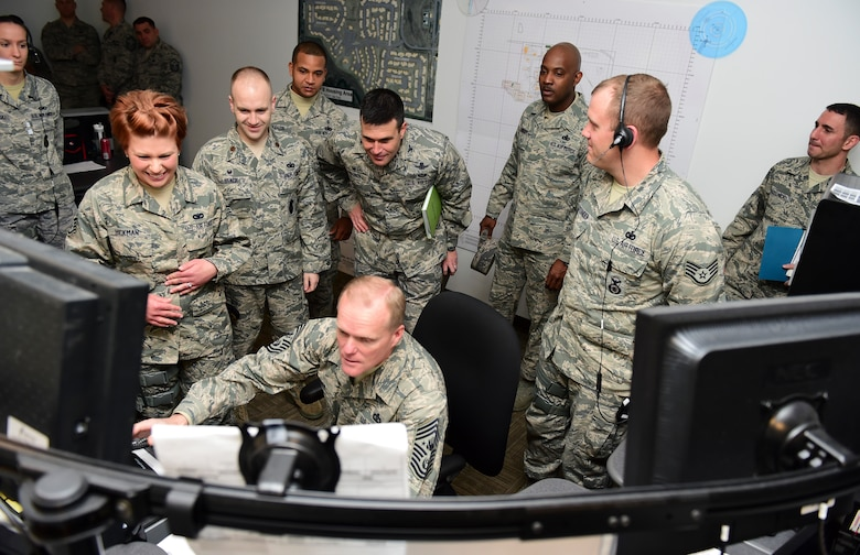 Chief Master Sgt. of the Air Force James A. Cody tests out the new Base Defense Operations Center in the 460th Security Forces Squadron March 5, 2015, at Buckley Air Force Base, Colo. Cody toured Buckley and spoke with Airmen on the future of the Air Force. (U.S. Air Force photo by Airman 1st Class Luke W. Nowakowski/Released)