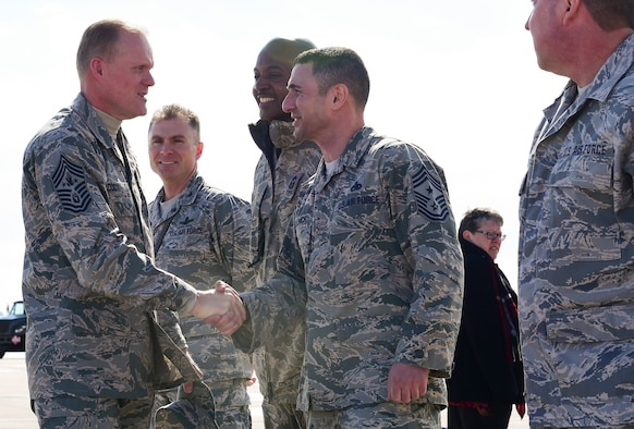 Chief Master Sgt. of the Air Force James A. Cody greets Chief Master Sgt. Brian Kruzelnick, 460th Space Wing command chief, upon his arrival March 5, 2015, at Buckley Air Force Base, Colo. Cody toured Buckley and spoke with Airmen on the future of the Air Force. (U.S. Air Force photo by Airman 1st Class Luke W. Nowakowski/Released)
