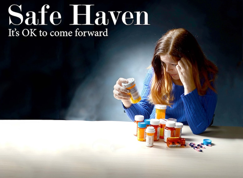 To best represent the struggles that go along with substance abuse problems, Robins Public Affairs photographer Tommie Horton asked Angela Woolen, Rev-Up reporter, to model for the photo illustration used on the front page of the base newspaper. Although prescription drugs were used for the illustration, all substance abuse problems are serious, and help is available. (U.S. Air Force photo illustration by Tommie Horton)