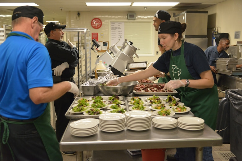 Green Team members are busy at work putting together a colorful appetizer dish. (U.S. Air Force photo by Ray Crayton)