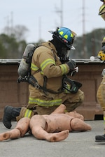 Darryl Phelps documents a casualty during the 2015 Crisis Response Drill at Marine Corps Air Station Cherry Point, N.C., March 3, 2015.  The annual exercise was designed to test Cherry Point's emergency preparedness program and response procedures. Phelps is a firefighter with Cherry Point's Fire and Emergency Services Department.