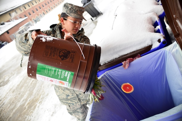 Senior Airman Grissel Reyes, 914th Force Support Squadron, disposes of compostable material at the Niagara Falls Air Reserve Station, Feb. 7, 2015. The base was participating in a recent recycling initiative. (U.S. Air Force photo by Tech. Sgt. Stephanie Sawyer)