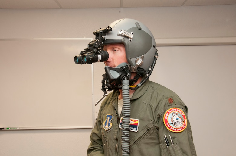 "Pilots don't choose the time of day they are put in harm's way. Thus, Maj. Erik Brettingen, a Norwegian exchange officer at the 162nd Wing, familiarizes himself with Night Vision Goggles (NVG). Brettingen, who also serves as a flight commander for Norwegian student-pilots at the F-16 Schoolhouse, said that although NVGs do ""not turn night into day,"" the pilot is able to detect threats and targets and stay in formation in an operational environment during the night. (U.S. Air National Guard photo by 2nd Lt. Lacey Roberts)"