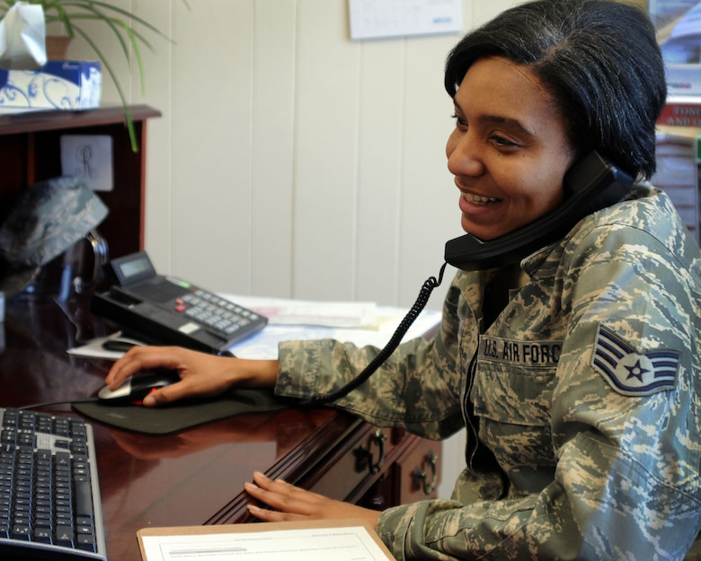 Staff Sgt. Sharia Stewart who serves as a 111th Attack Wing personnelist, Horsham Air Guard Station, Pennsylvania, multi-tasks while working in the wing commander's office during the unit training assembly March 7, 2015. The 111th AW is celebrating Women's History Month by recognizing some of its own members throughout the month. (U.S. Air National Guard photo by Tech. Sgt. Andria Allmond/Released)