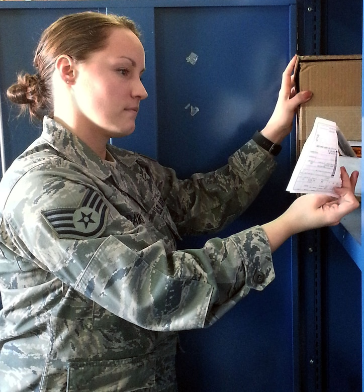Staff Sgt. Brittany Adams, 111th Logistics Readiness Squadron supply management technician, stacks boxes of clothing supplies, March 6, 2015, Horsham Air Guard Station, Pennsylvania. The 111th Attack Wing is celebrating Women's History Month by recognizing some of its own members throughout the month of March (U.S. Air National Guard Photo by Tech. Sgt. Andria Allmond/Released)