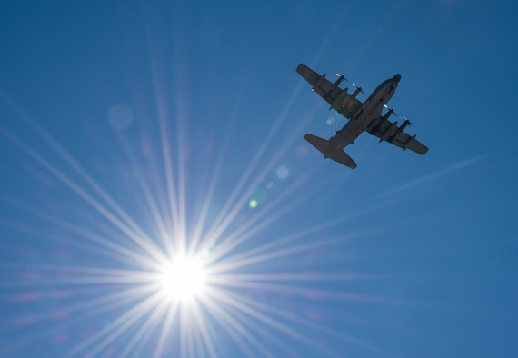 A C-130 soars by the sun while doing some pattern work over Duke Field's flightline Jan. 28.  (U.S. Air Force photo/Tech. Sgt. Jasmin Taylor)