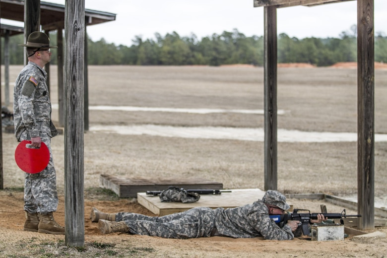 Army Reserve drill sergeant, Staff Sgt. Kurt Schoeller, 3-518 Inf., 98th Training Division (IET), checks targets at the qualification range during week four of Basic Combat Training at Fort Jackson, S.C. Schoeller, is performing his second echo mission in which a team of drill sergeants and support personnel take over a basic training company to provide quality instruction and mentorship alongside their active duty counterparts at each of the Army's four initial entry training posts. (U.S. Army photo by Sgt. 1st Class Brian Hamilton)