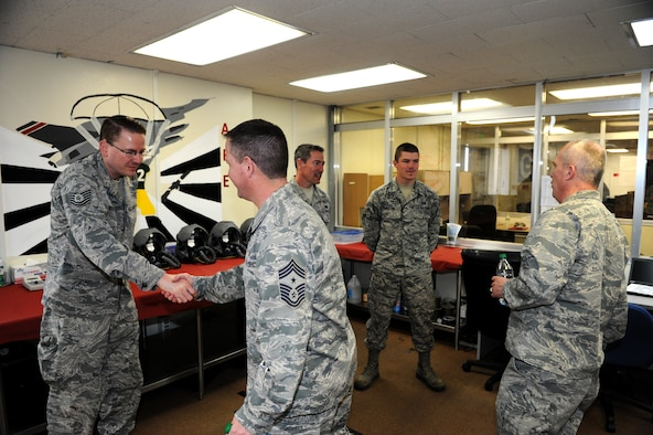 U.S. Air Force Chief Master Sgt. Gregory Cullen, Wisconsin Air National Guard command chief, and Brig. Gen. Gary Ebben, Wisconsin National Guard assistant adjutant general, greet members of the 176th Fighter Squadron, Wisconsin Air National Guard, during a visit to Kadena Air Base, Japan, March 4, 2015. They visited Kadena to see how the Wisconsin Air National Guard deployment to Kadena is going and what kind of impact they have on the mission here. (U.S. Air Force photo by Airman 1st Class Stephen G. Eigel)