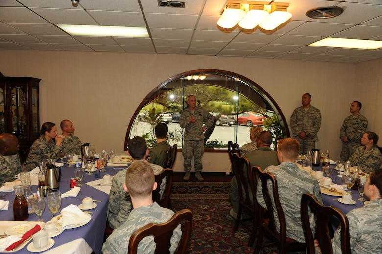 U.S. Air Force Brig. Gen. Gary Ebben, Wisconsin National Guard assistant adjutant general, speaks to members of the 115th Fighter Wing from the Wisconsin Air National Guard during a lunch at the Officer's Club on Kadena Air Base, Japan, March 4, 2015. During the lunch, a few awards were given out and a lieutenant was promoted to captain. (U.S. Air Force photo by Airman 1st Class Stephen G. Eigel)