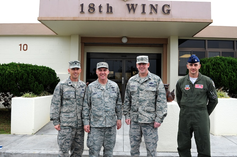 From left to right, U.S. Air Force Lt. Col. Matt Eakins, 176th Fighter Squadron maintenance officer in charge, Brig. Gen. Gary Ebben, Wisconsin National Guard assistant adjutant general, Brig. Gen. James B. Hecker, 18th Wing, commander, and Lt. Col. Jon Kalberer, 176th FS commander,  pose for a photo in front of the wing building on Kadena Air Base, Japan, March 4, 2015. Ebben was here to see how the Wisconsin Air National Guard deployment to Kadena is being completed. (U.S. Air Force photo by Airman 1st Class Stephen G. Eigel)