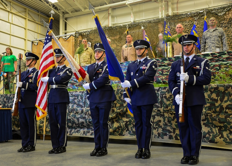 Members of the Eglin AFB Honor Guard present the colors at the Combat Dining-In Feb. 7 at Duke Field, Fla.  The event, the first in nine years, drew more than 250 Airmen.  A Combat Dining-In is built around the format of a traditional Dining-In, but there is less formality and combat uniforms are required. (U.S. Air Force photo/Tech. Sgt. Cheryl L. Foster)