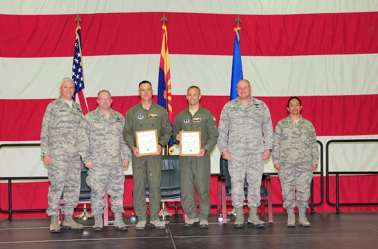 The 161st Air Refueling Wing, Phoenix Air National Guard Base, held its annual awards ceremony March 8.  The Copper Five award is presented to aircrew members who have best represented the professional skills and leadership demonstrated by the crew of Copper Five. From left, U.S. Air Force Brig. Gen. Edward Maxwell, commander of the Arizona Air National Guard; Col. Chris Triebel, 161st Operations Group commander; Lt. Col. Dean Owen, 1st Lt. William Johnson, Col. Gary Brewer, commander of the 161st Air Refueling Wing and Chief Master Sergeant Martha Garcia, 161st Air Refueling Wing command chief. (U. S. Air National Guard photo by Master Sgt. Kelly M. Deitloff)