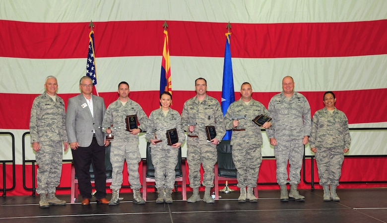 The 161st Air Refueling Wing, Phoenix Air National Guard Base, held its annual awards ceremony March 8.  The ceremony recognized the Outstanding Airmen of the year. From left, U.S. Air Force Brig. Gen. Edward Maxwell, commander of the Arizona Air National Guard; Mr. Dean Butler, president of the Phoenix Air National Guard Patriots; Senior Airman Justin Klosterman, Airman of the Year; Tech. Sgt. Cherry Rose Ayulo, junior noncommissioned officer of the year; Master Sgt. James Swanson, senior noncommissioned officer of the year; Staff Sgt. David Griffin, command chief award recipient; Colonel Gary Brewer, commander of the 161st Air Refueling Wing and Chief Master Sergeant Martha Garcia, 161st Air Refueling Wing command chief. (U. S. Air National Guard photo by Master Sgt. Kelly M. Deitloff)