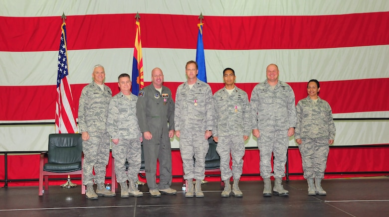 The 161st Air Refueling Wing, Phoenix Air National Guard Base, held its annual awards ceremony March 8.  The ceremony recognized members who received the federal Meritorious Service Medal.  This military decoration is awarded to the following Airmen for unique accomplishments in their particular fields, or for distinguished careers in the service of our country. From left, U.S. Air Force Brig. Gen. Edward Maxwell, commander of the Arizona Air National Guard, Lt. Col. Christopher Parot, Col. Hoyt Slocum, Lt. Col. Darcy Swaim, Maj. Gilbert Besana, Col. Gary Brewer, commander of the 161st Air Refueling Wing and Chief Master Sgt. Martha Garcia, 161st Air Refueling Wing command chief. (U. S. Air National Guard photo by Master Sgt. Kelly M. Deitloff)