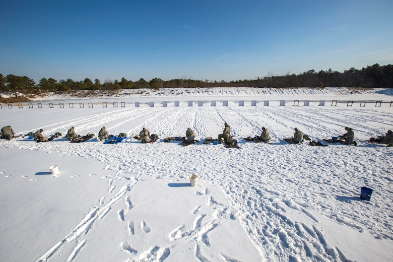 Airmen from the 108th Wing, New Jersey Air National Guard, prepare to qualify on the M4 Carbine at Joint Base McGuire-Dix-Lakehurst, N.J., March 8, 2015. (U.S. Air National Guard photo by Master Sgt. Mark C. Olsen/Released)