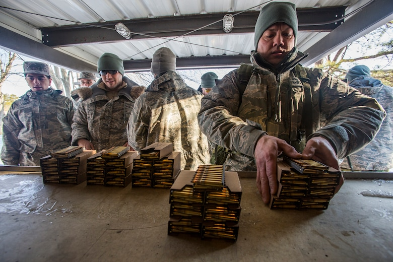 Airmen from the 108th Wing, New Jersey Air National Guard, pick up boxes of 5.56mm ammunition in preparation for qualifying on the M4 Carbine at Joint Base McGuire-Dix-Lakehurst, N.J., March 8, 2015. (U.S. Air National Guard photo by Master Sgt. Mark C. Olsen/Released)