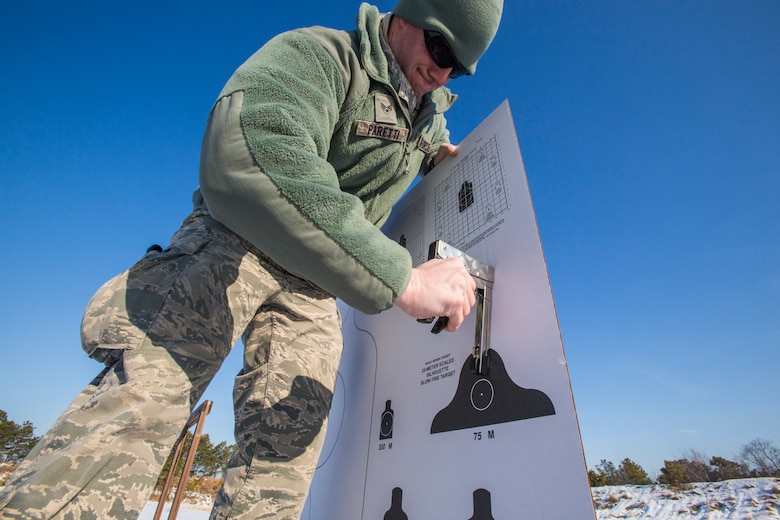Senior Airman Joseph C. Paretti, Combat Arms Training and Maintenance, 108th Wing, New Jersey Air National Guard, attaches a target in preparation for 108th Airmen qualifying on the M4 Carbine at Joint Base McGuire-Dix-Lakehurst, N.J., March 8, 2015. (U.S. Air National Guard photo by Master Sgt. Mark C. Olsen/Released)