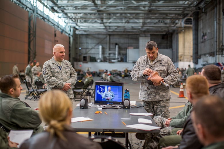 Master Sgt. Tim Tremarche, 101st Intelligence Squadron signals intelligence element supervisor, demonstrates how to use a nasal flange to 102nd Intelligence Wing Airmen March 6, 2015 at Otis Air National Guard Base, Mass. Approximately 350 Airmen from the 102nd IW participated in hands-on training which covered self-aid buddy care and chemical, biological, radiological and nuclear defense. (Air National Guard photo by Staff Sgt. Jeremy Bowcock)