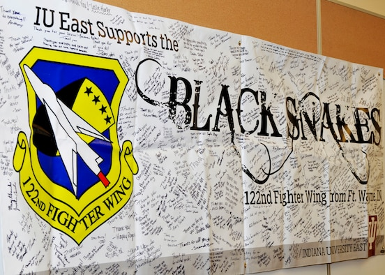 The support banner provided by the Student Veterans Organization from Indiana University East hangs in the training room of the 122nd Security Forces Squadron, March 7, 2015 at the Fort Wayne Air National Guard Base, Fort Wayne, Indiana. The SVO also sent sweatshirts, T-shirts and caps to the deployed Airmen overseas. (U.S. Air Force Photo by TSgt Kurt Briner)