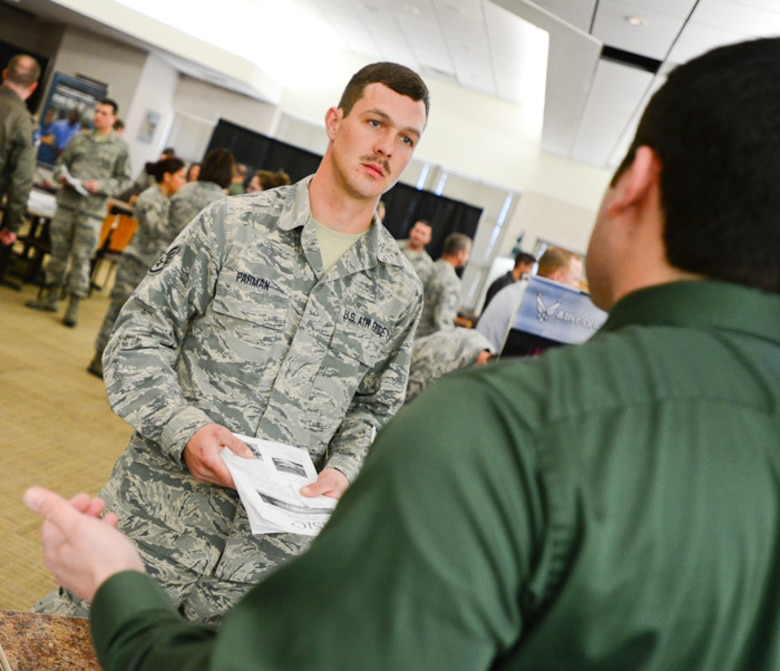 Staff Sgt. James Parman, crew chief of the 137th Aircraft Maintenance Squadron, listens to a representative from the career fair at Will Rogers Air National Guard Base, Oklahoma City, Oklahoma, Saturday, March 7, 2015. WRANGB hosted over 10 civilian and military employers for Airmen searching for full-time employment.  (U.S. Air Force photo by Airman 1st Class Tyler Woodward/released)