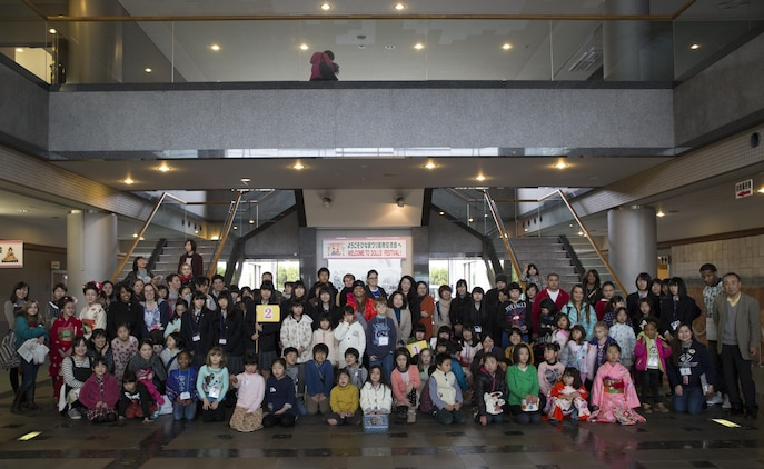 Visitors, volunteers and staff pose for a picture after the closing ceremony at the Hina Doll Festival in Shunan City, Japan, March 7, 2015. Shunan International Children's Club invited School Age Care aboard Marine Corps Air Station Iwakuni, to celebrate the Hina Doll Festival at the Shinnanyo Fureai Center in Shunan City. The Hina Doll Festival, or Hinamatsuri, is a day in Japan when parents celebrate their daughters' happiness, growth and good health and is usually held on March 3.