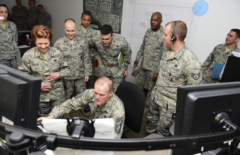 Chief Master Sgt. of the Air Force James A. Cody tests out the new base defense operations center in the 460th Security Forces Squadron March 5, 2015, at Buckley Air Force Base, Colo. Cody toured Buckley AFB and spoke with Airmen on the future of the Air Force. (U.S. Air Force photo/Airman 1st Class Luke W. Nowakowski)