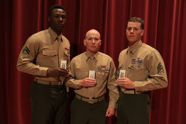 Cpl. Keontaye Dawson, SSgt. Elliott Stanton and Sgt. Tanner Bauer receive gold medals at the awards ceremony of the Competition-In-Arms Program (CIAP) Western Divisional at Marine Corps Base Camp Pendleton, Calif., March 6, 2015.  The Marines, all based at Marine Corps Air Station Yuma, Ariz., have placed in the top ten percent of approximately 240 regional Marine and civilian competitors during the two-week competition.