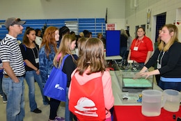 Held at Woodville Tompkins Technical and Career High School, Girls Engineer It Day attracted hundreds of area middle and high school students who learned about career opportunities in the STEM fields. Savannah District volunteers Sarah Wise, Sherelle Reinhardt and Beth Williams brought an interactive wetlands model, which demonstrated how dams and levees are used to mitigate flooding and manage water resources.
