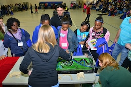 Held at Woodville Tompkins Technical and Career High School, Girls Engineer It Day attracted hundreds of area middle & high school students who learned about career opportunities in the STEM fields. Savannah District volunteers Sarah Wise, Sherelle Reinhardt and Beth Williams brought an interactive wetlands model, which demonstrated how dams and levees are used to mitigate flooding and manage water resources