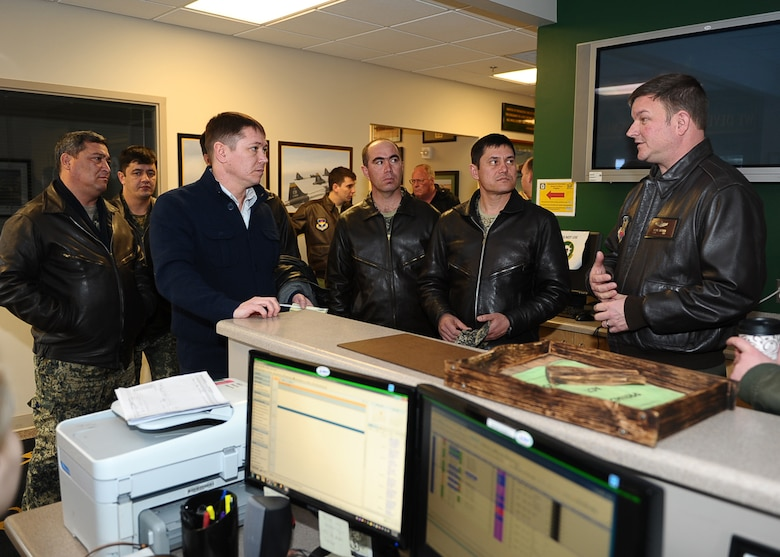 Lt. Col. Wayne Chitmon speaks with Uzbekistan air force members about the 14th Flying Training Wing's Introduction to Fighter Fundamentals training program March 5, 2015, at Columbus Air Force Base, Miss. The Uzbek troops came here to get a first-hand experience in how they could structure their own pilot training program. Chitmon is the 49th Fighter Training Squadron assistant director of operations. (U.S. Air Force photo/Airman Daniel Lile)