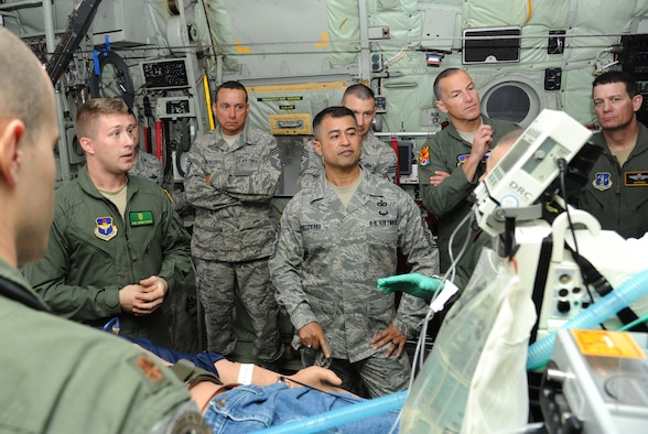 Staff Sgt. Joshua Taylor, 81st Medical Operations Squadron cardiopulmonary technician, briefs Air Education and Training Command senior leaders on critical care air transport team procedures aboard a C-130J Hercules aircraft during the AETC Senior Leader Conference March 4, 2015, inside the dual bay hangar, Keesler Air Force Base, Miss. Commanders and chief master sergeants from across AETC attended the conference, which gave senior leaders an opportunity to collaborate and share ideas as they shape the future of the command.  (U.S. Air Force photo by Kemberly Groue)