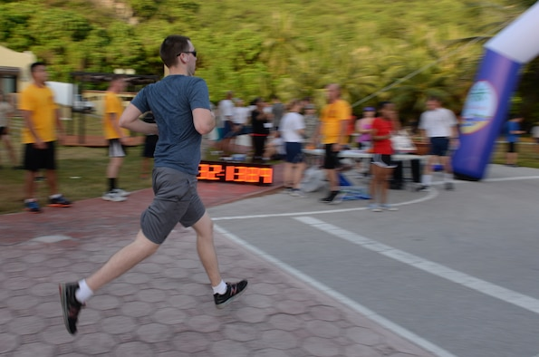 A participant races to the finish line during the Women's History Month 5K March 6, 2015, at Andersen Air Force Base, Guam. More than 150 participants from across the base joined together to kick-off the first event of Women's History Month. (U.S. Air Force photo by Senior Airman Amanda Morris/Released)