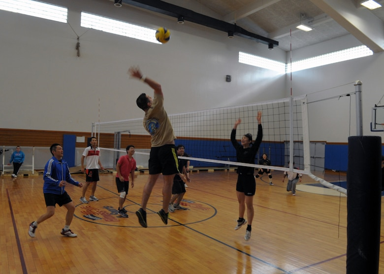 Adam Bearden soars for a spike during an invitational volleyball tournament Feb. 28, 2015, at Kadena Air Base, Japan. Members of the Company Grade Officer Council and Airmen Committed to Excellence invited two Japanese teams to the base for a day of sportsmanship and camaraderie, and Bearden played with the Japan Air Self-Defense team from Naha Air Base during one of the games. (U.S. Air Force photo by Tim Flack)