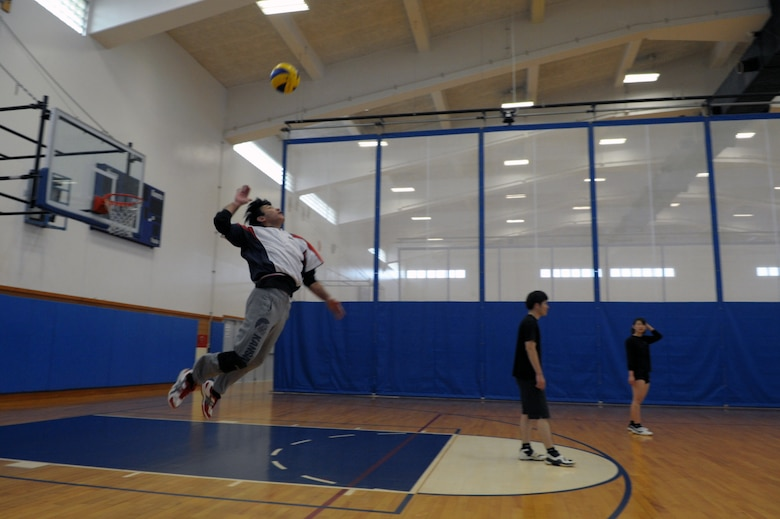 Katsuhiko Nakachi, chief of directors for the Okinawa City Volleyball Association, jump serves during an invitational volleyball tournament Feb. 28, 2015, at Kadena Air Base, Japan. Members of the Company Grade Officer Council and Airmen Committed to Excellence invited two Japanese teams to the base for a day of sportsmanship and camaraderie. (U.S. Air Force photo by Tim Flack)