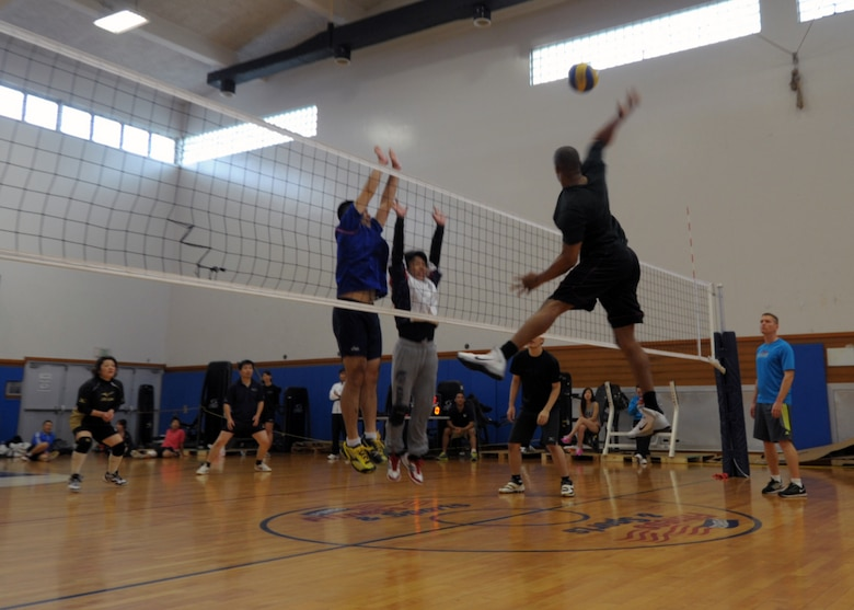 Jeremy Turner leaps for a spike against a team from Okinawa City during an invitational volleyball tournament Feb. 28, 2015, at Kadena Air Base, Japan. Members of the Company Grade Officer Council and Airmen Committed to Excellence invited two Japanese teams to the base for a day of sportsmanship and camaraderie. (U.S. Air Force photo by Tim Flack)