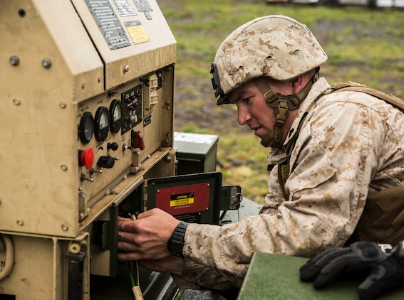 Cpl. Alexander S. Romero works on a generator to provide communication and other equipment with power March 5 during Dragon Fire Exercise 15-2 at Pohakuloa Training Area. Communication is an essential piece of the forward command to be able to operate continuously as the main command element prepares to advance. Romero, a Lincoln, Nebraska native, is an artillery fire control man for Headquarters Battery, 12th Marine Regiment, 3rd Marine Division, III Marine Expeditionary Force.